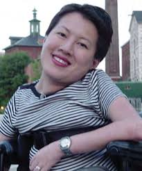 Close up of Ing Wong-Ward in striped tee-shirt smiling at the camer